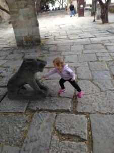 She Would Only Touch The Lion Statue With a Stick Photo Taken By Jennifer Mitchell