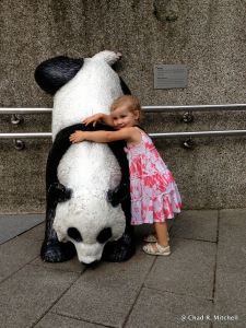 Z hugging a panda statue (that was made to look as though it is marking it's territory)