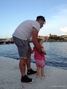 Chad and Zoë checking out crabs in the water, Curacao April 2013
