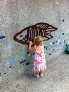 Zoë loves the sculptures on the walk to the Taipei Zoo