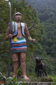 A statue of an aboriginal man and his dog