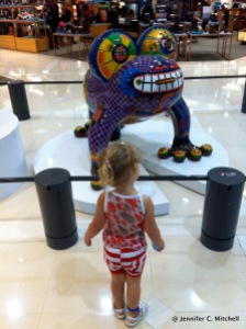 Zoë checking out some art at a department store