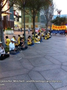 I am not sure what this is all about, but they are always sitting and meditating outside of Taipei 101