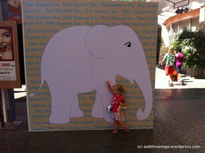 At the Jungceylon Mall in Patong Phuket they are having a kind of art show to bring awareness to the plight of Thai elephants. This was the sign for it and Z loved it.