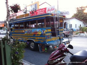 A public bus here on Phuket Island. They run from town to town without any kind of schedule. If you are able to find one and flag it down, it only costs 20 baht per person.