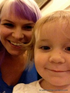 That's me with platinum blonde hair and purple bangs (fringe) hamming it up with Zoë.