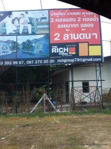 """I took this while driving... so not the best shot, but I was amused that people could love in the """"Rich Villa's"""" by the Rich Group. I guess they are really trying to sale a lifestyle, too. Haha."""